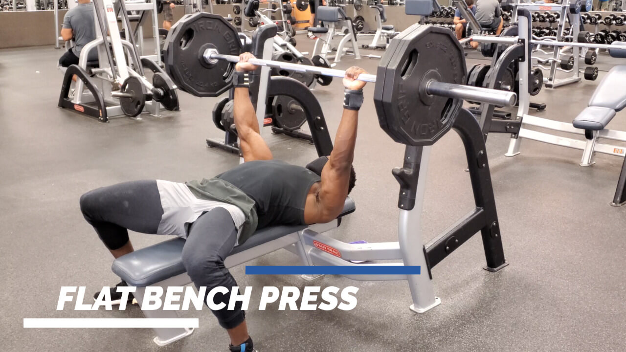 nurudeen performing flat barbell bench press and incline barbell bench press