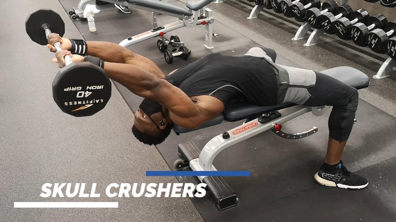 Nurudeen performing skull crushers aka lying triceps extension